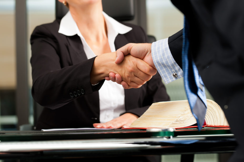 A person shaking hands with a future employer