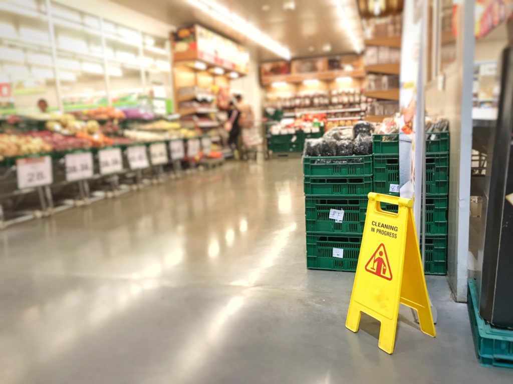 a supermarket with a wet floor sign